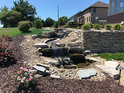 Beautiful water features enhance custom garden designs.